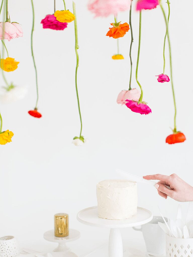 Hanging flower backdrop idea from Sugar & Cloth