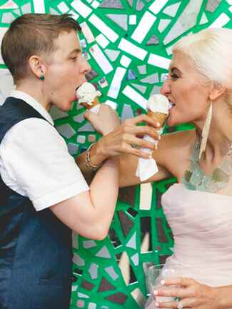 Brides eating ice cream cones on their wedding day