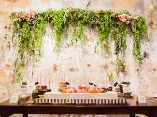 Whimsical doughnut display with floating green garland