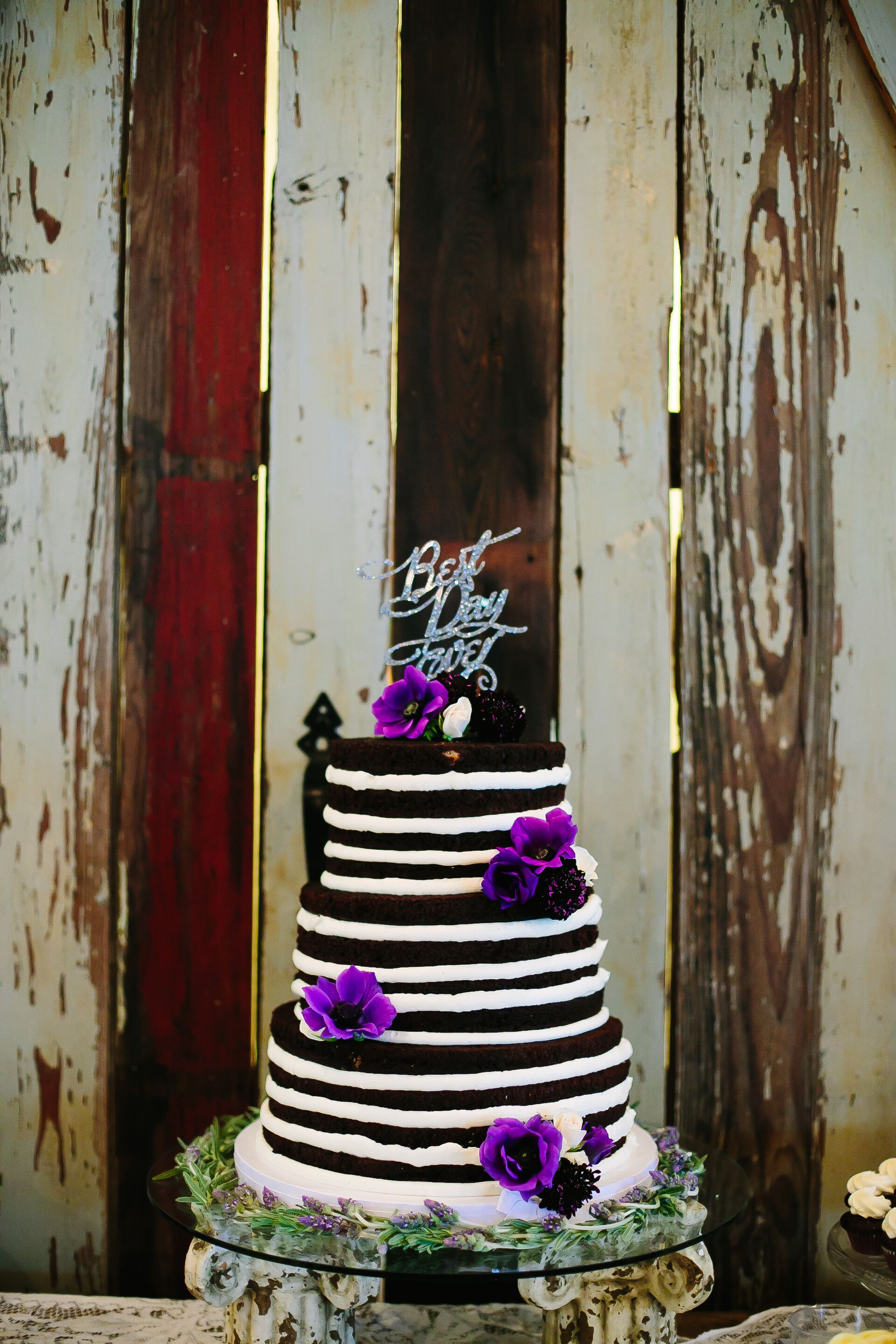 Black and white naked cake with purple flowers