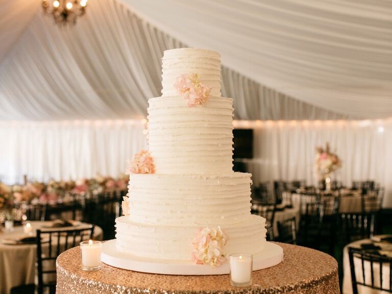White Four Tier Wedding Cake With Blush Blooms