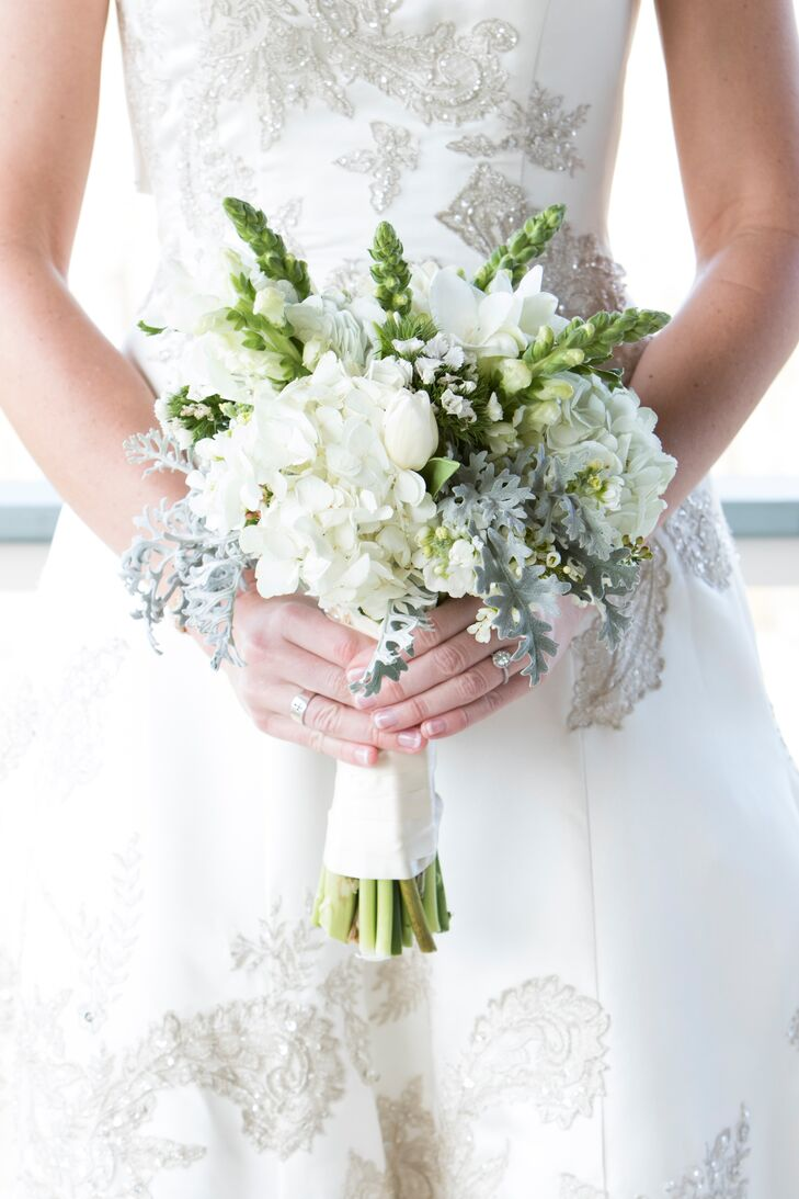 The wedding flowers were all white to maintain the classic style. Leigh carried a wintery bouquet of white hydrangea with dusty miller.