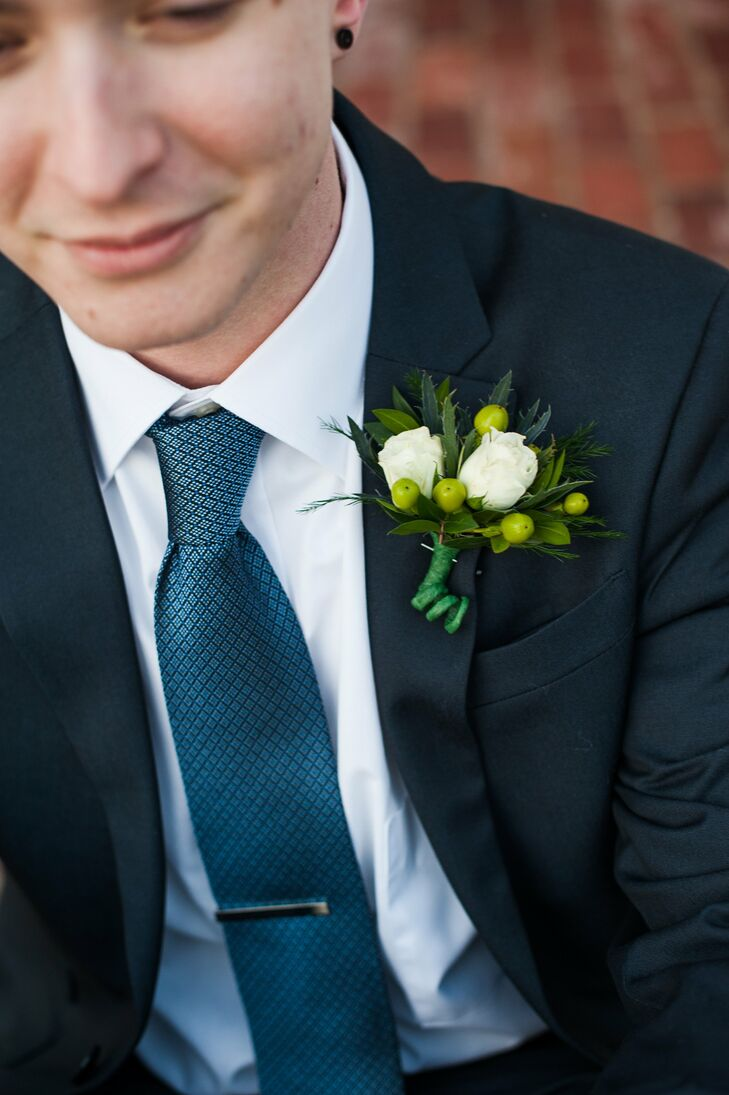 Ryan's white rose boutonniere was complemented by small green hypericum berries.