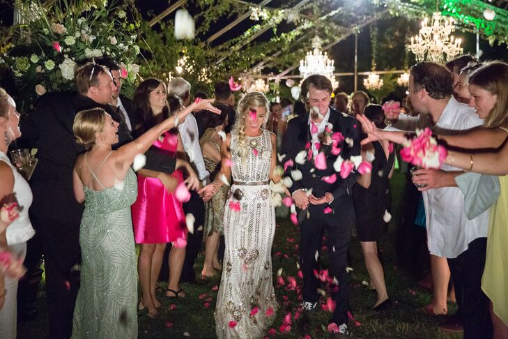 """We did not have a planned or formal exit, but the guests made a tunnel that we walked through while they threw flower petals in the air at the end of the night,"" Lauren says."