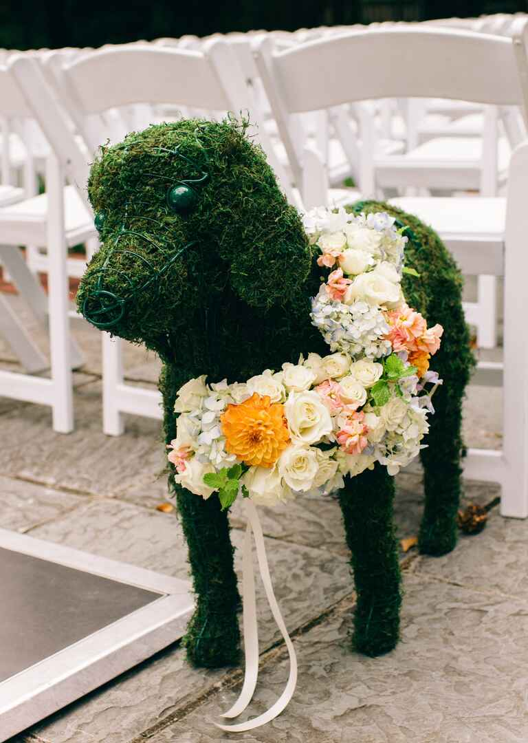 Life-size moss topiary of the couple's dog