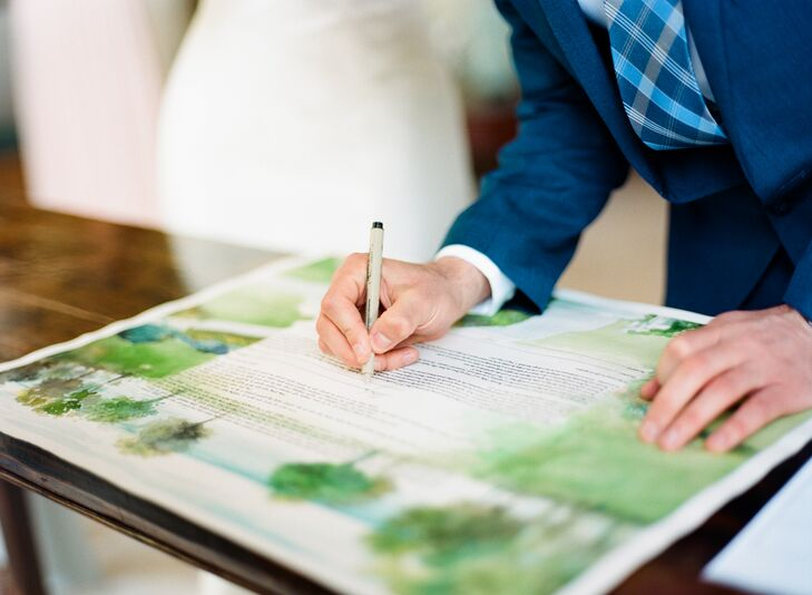 "Before the couple's Jewish ceremony, Jamie and Alex signed a ketubah (Jewish wedding contract), which was painted by the bride's father. ""He did a watercolor of the view from the balcony of the inn,"" Jamie says. ""It felt perfect, since my dad had picked that inn for us to visit on our Maine vacation almost 10 years earlier."""