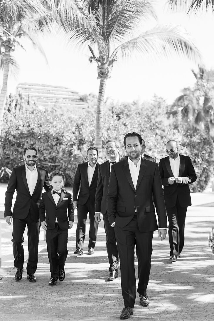 To match the elegant but simple beach ceremony,  Vincent and his groomsmen sported elegant black suits without ties.