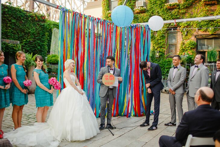 """Neither of us are religious, so we made up a lighthearted ceremony with our officiant, Chris, and his wife, Dara, one of my best friends,"" Risa says. ""Weeks earlier, when Dara read me what she had written, we both sat on a park bench and cried happy tears together. It was so special and personal."" The pair exchanged vows they'd written themselves against a brilliant backdrop of colorful ribbons, and just as they were pronounced husband and wife, the Hungry March Band made their grand entrance and whisked the newlyweds into the reception at the Foundry in Long Island City, New York."