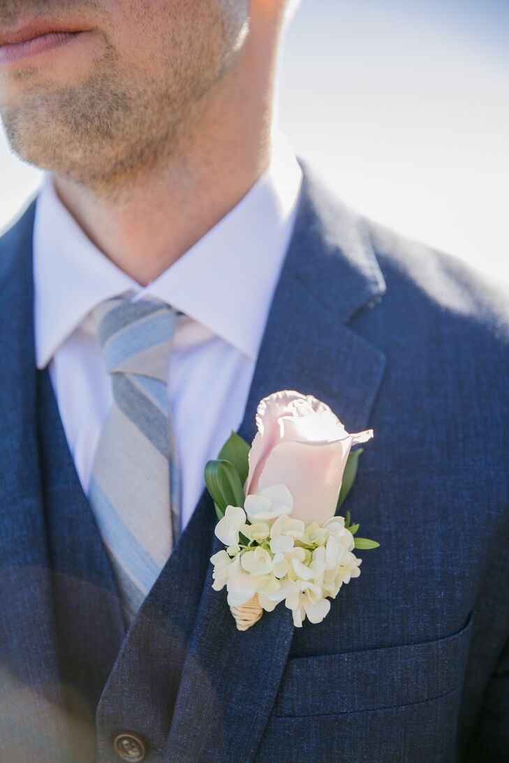 Matt had a pink rose and ivory hydrangea boutonniere pinned to the lapel of his navy blue suit jacket. The colors of the boutonniere went with the brown-and-blue-striped tie, tying his whole look together.
