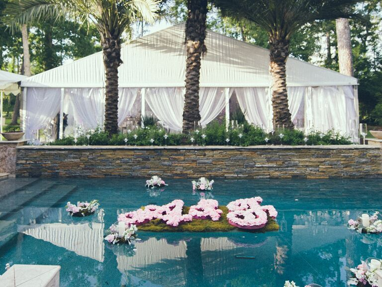 Outdoor wedding with floating floral monogram