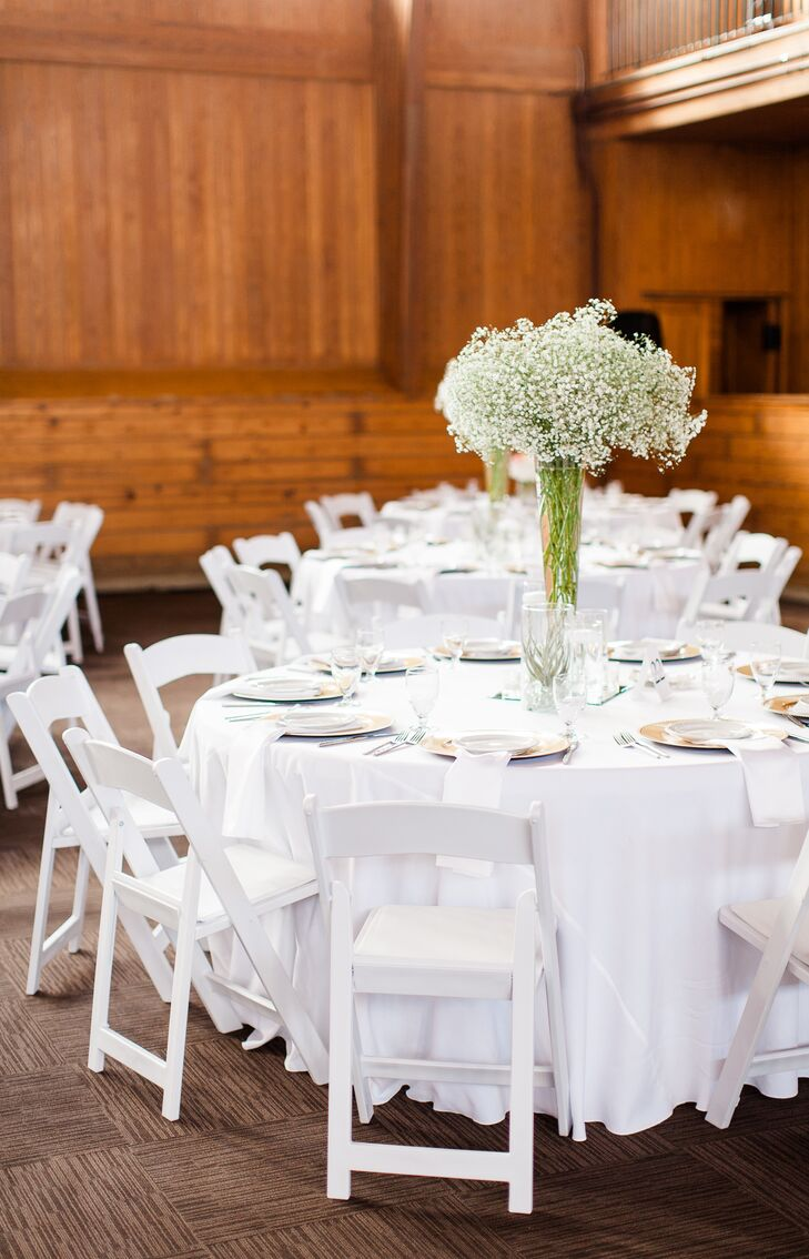 Round dining tables covered in white linens embodied a clean, classic look that Jenna and Tyler had envisioned for their wedding. The tables had centerpieces of short and tall baby's breath arrangements, resembling the bouquets held by Jenna and her bridesmaids.