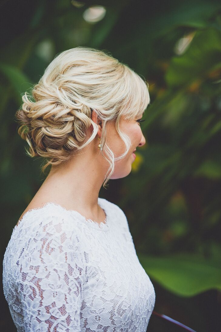 The team at Casa Salon in Key West, Florida, helped Danielle capture a timeless look on her wedding day. She complemented her all-lace white wedding dress with natural makeup and a classic updo with side-swept bangs.