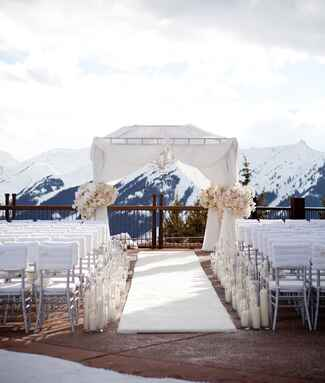 Aspen winter wedding ceremony with faux fur accents