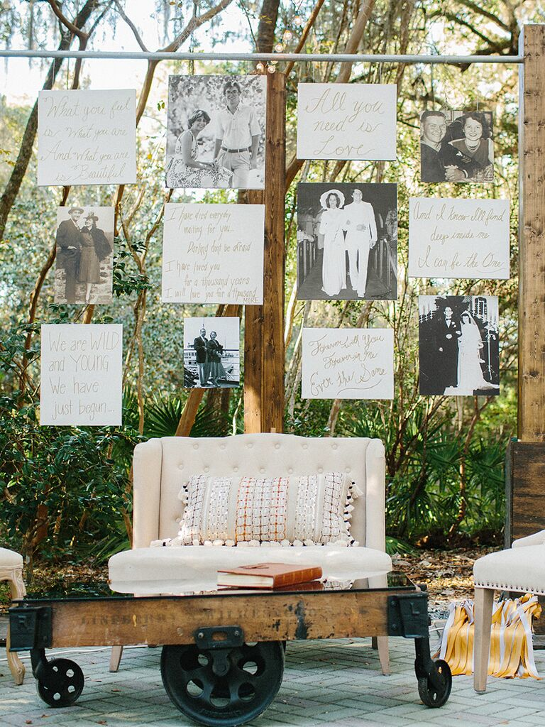 Family photo wall at outdoor wedding reception