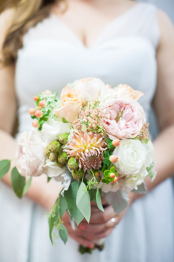Caitlyn's bouquet had a wildflower feel, with mixed blush, yellow, white and peach blooms. The peach hypericum berries were a great touch to match the theme.