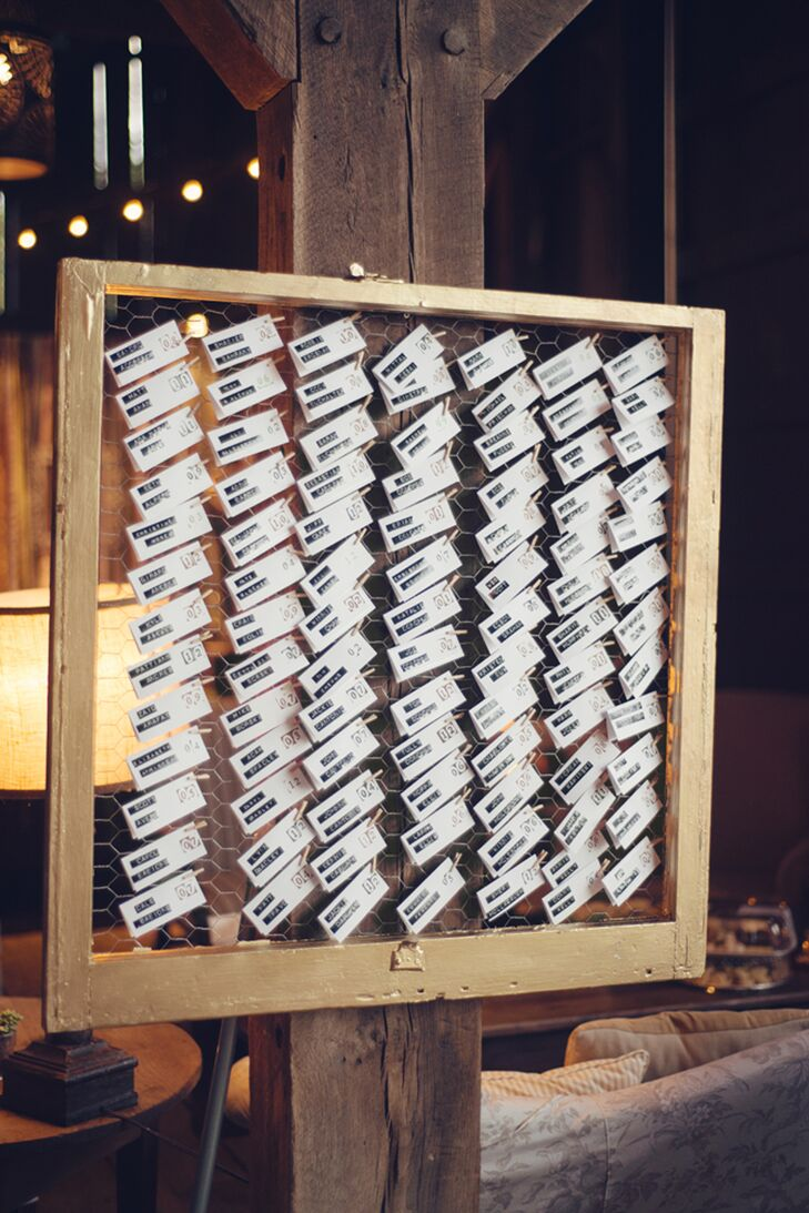 Who knew an old-school label maker could do this? Erin and Cory's 170 guests found their names embossed on a black-and-white label and attached to simple white escort cards as they entered the barn reception. For a fun twist, the cards were either hung on a repurposed, gold window pane or placed on a shabby-chic table surrounded by succulents.