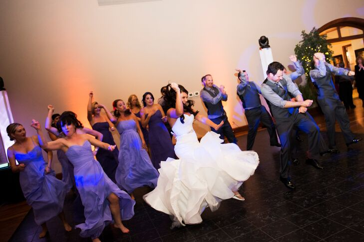 "As a wedding gift, Cara'a cousin hired an old friend to choreograph a group dance at the reception. ""Before the dance began, the DJ announced all 16 wedding party members to silly nicknames (assigned by us!) as if they were a basketball team while playing 'Sirius' by the Alan Parsons Project in the background,"" Cara says. ""When it came to announce the happy couple, we came out across the large ballroom to 'I feel so close to you Right Now' by Calvin Harris. From there, we joined they wedding party on the other side and busted out into a hilarious mob flash. The entire venue went nuts, not expecting it, and it set the tone of fun for rest of the night."""