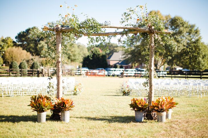Rustic Wooden Wedding Arch With Wildflowers