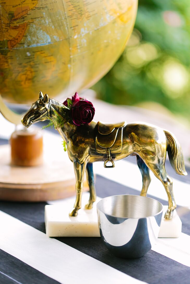 Paige's true passion are her horses: She's been riding and showing horses for most of her life, so her wedding wouldn't have been her style without lots of equine touches. She incorporated lots of vintage horse figurines, ribbons and saddles in her decor to showcase her favorite hobby. (We love how this horse figurine is even wearing a mini floral wreath.)