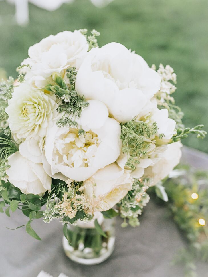 "St. Ive's Florist designed the bridal and bridesmaid bouquets. ""For my bouquet, I knew I had to have peonies, tulips and hydrangeas because those are my three favorite flowers,"" Kaasi says. ""I did all white with greenery for the colors and the beauty."""
