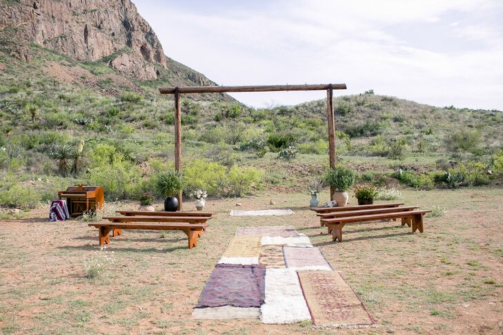 Rustic Wooden Wedding Arch With Vintage Rug Aisle