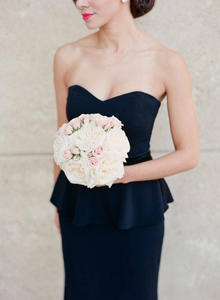 The bridesmaids carried white garden roses accented with smaller blush roses. Lynn really wanted each lady to carry a small, simple bouquet that they wouldn't hate holding for the entire ceremony, and her florist totally got it.