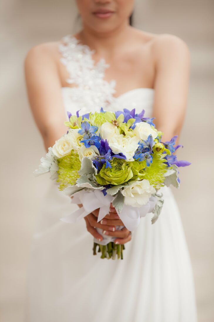 Cielito's bouquet was an arrangements of purple-blue orchids with white roses and lime green garden roses, orchids and dahlias—all tied together with a gorgeous white bow.