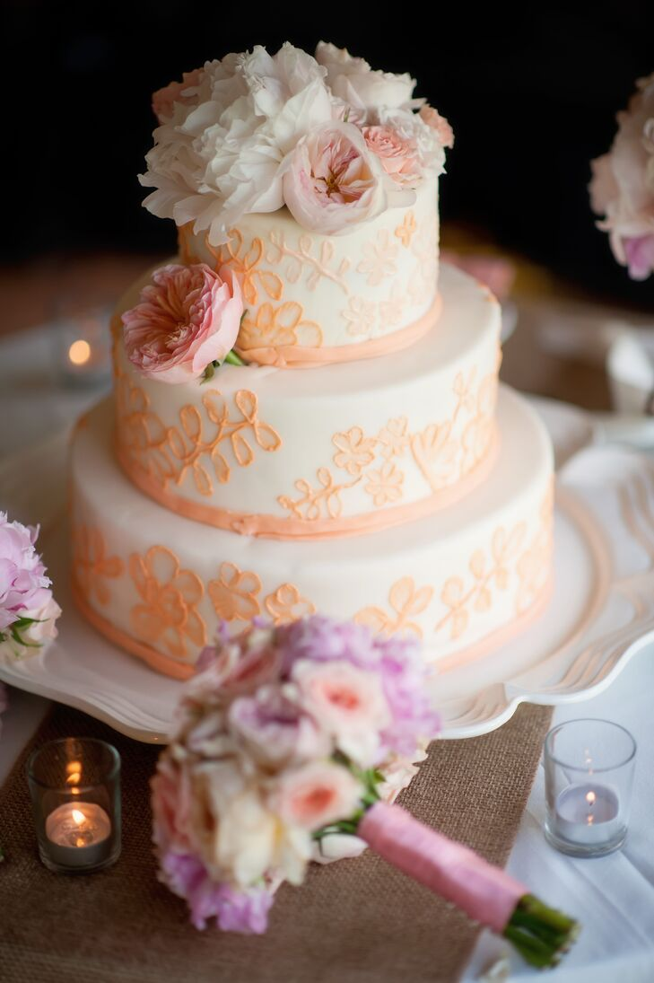 The blush  piping on Nellie and Chris's buttercream wedding cake was designed to mimic the lace from her reception dress.