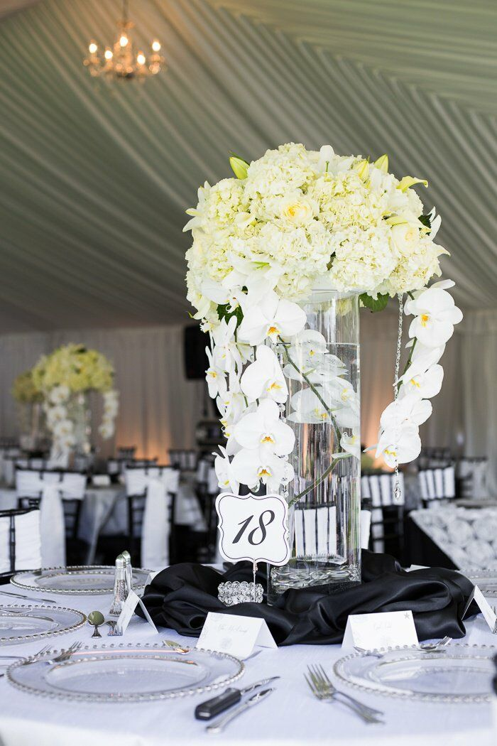Tall White Hydrangea Centerpiece : Tall white orchid and hydrangea centerpiece