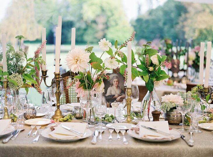 Candelabras, antique portraits and fine china created an elegant feel at the reception tables.