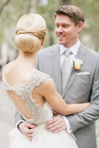 Bride with open-back beaded wedding gown