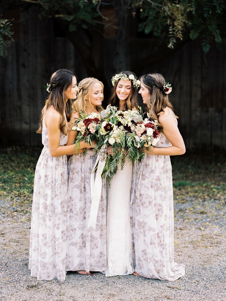 In keeping with the day's relaxed, bohemian theme, Julie's bridesmaids wore long, flowing gowns with a subtle floral print. Bouquets were a combination of dahlias, ranunculus, roses, hanging amaranthus, hanging pepperberries, snowberries, waxflowers, seeded eucalyptus, silver-dollar eucalyptus and olive branches.