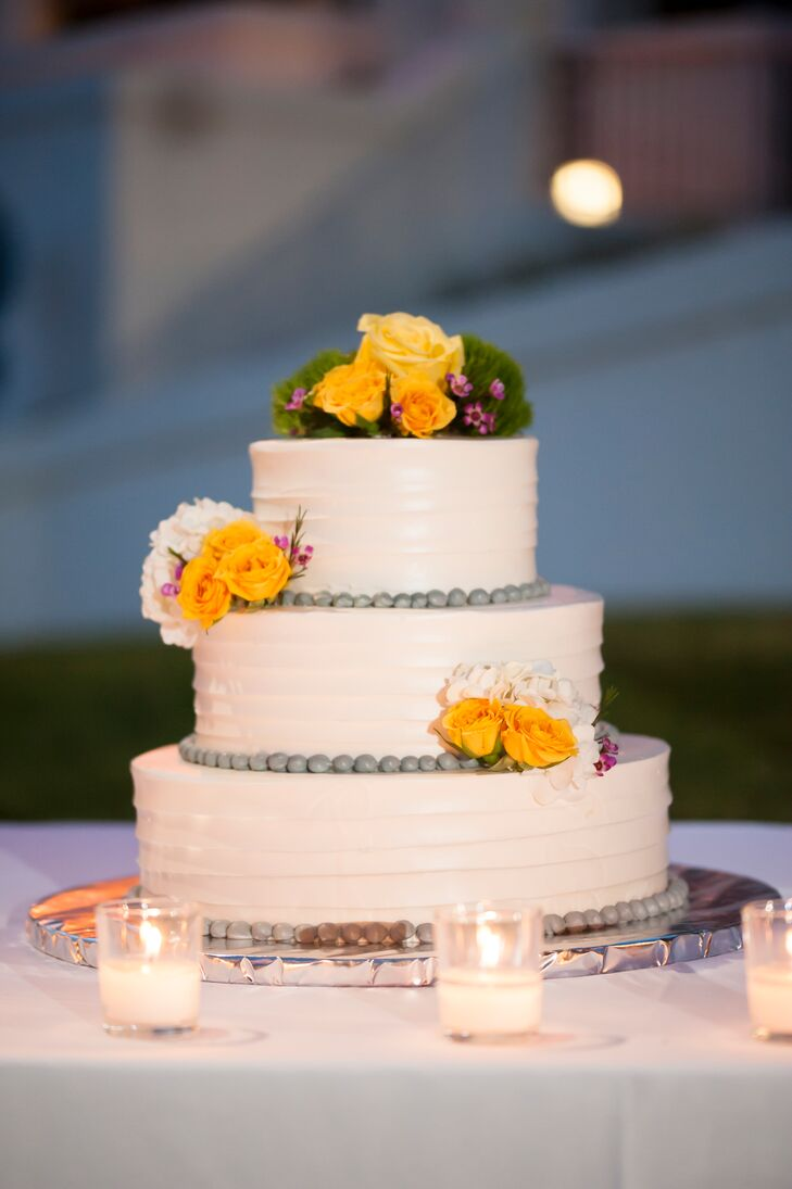 Classic White Wedding Cake With Yellow Flowers