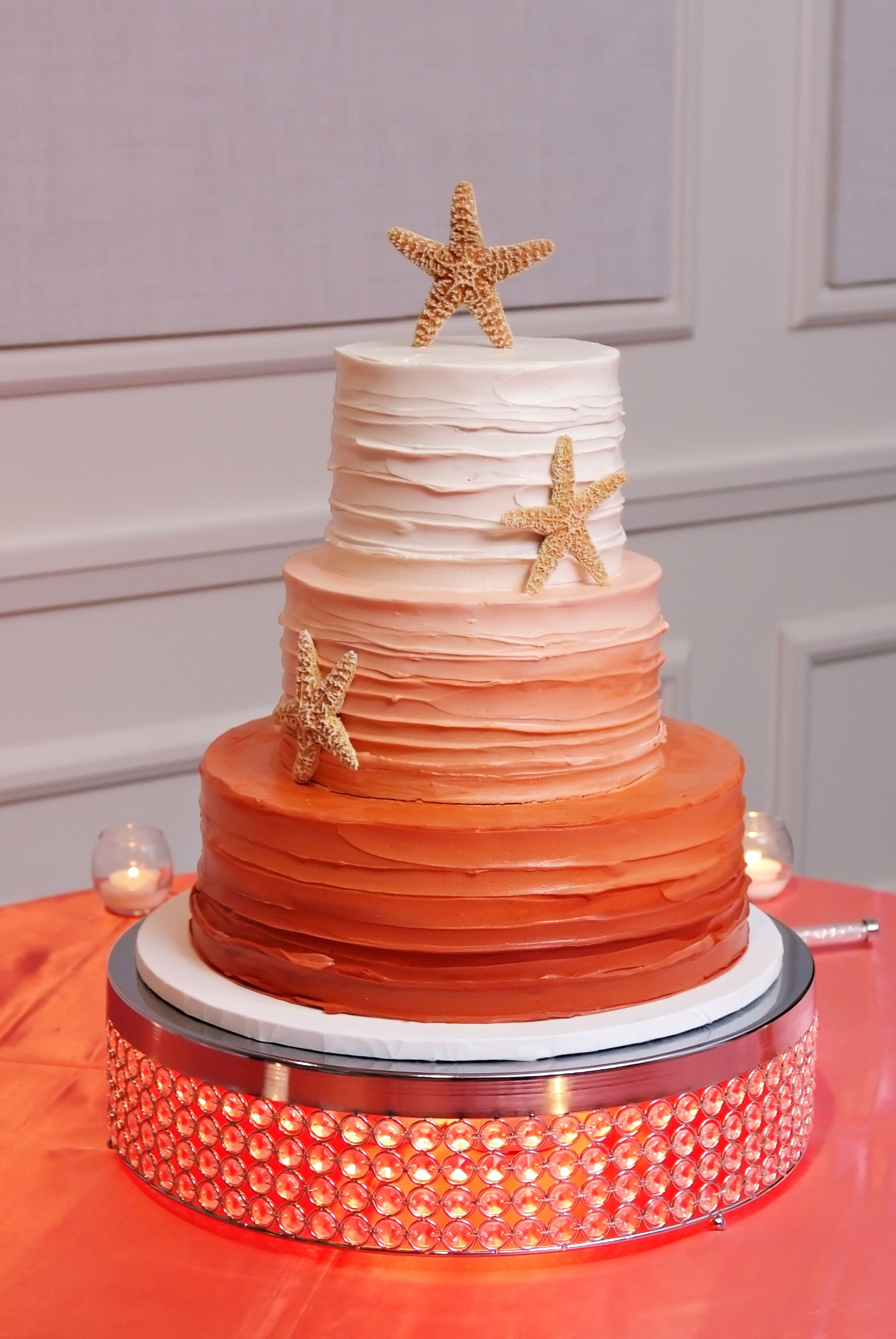 Three-Tiered Coral Ombre Wedding Cake