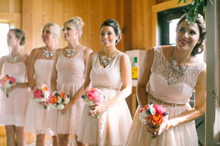 """My main requirement was that the dresses had to be blush colored with lace accents and for everyone to have a different style,"" Angela says. ""I didn't want them to be uniform but unique. I found four out of the five dresses on Modcloth.com, and each option was less than $100."""