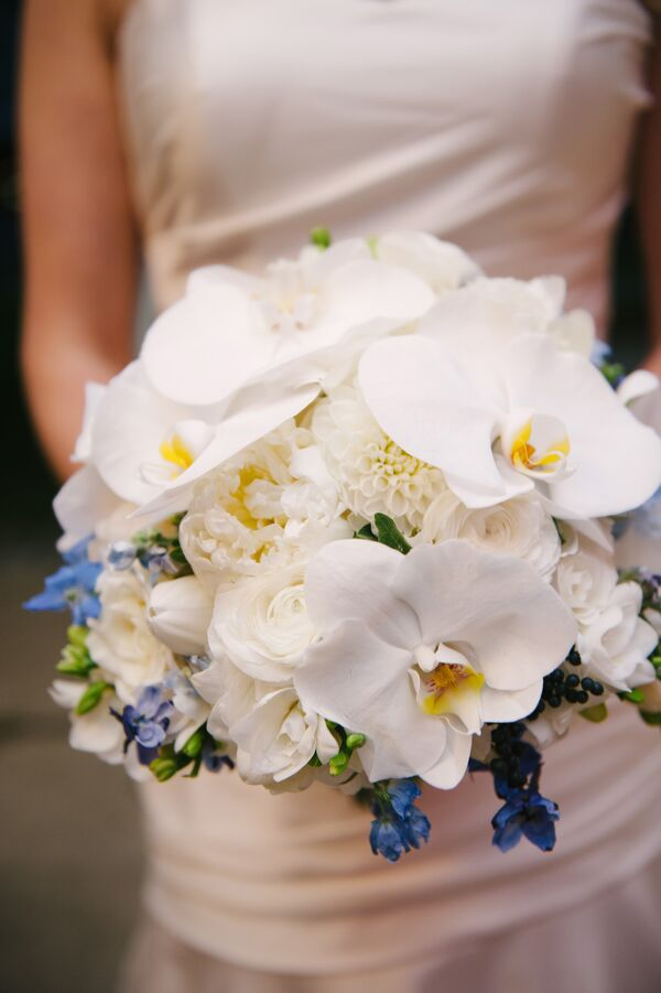 White orchid wedding bouquets modern orchid and ranunculus bouquet mightylinksfo