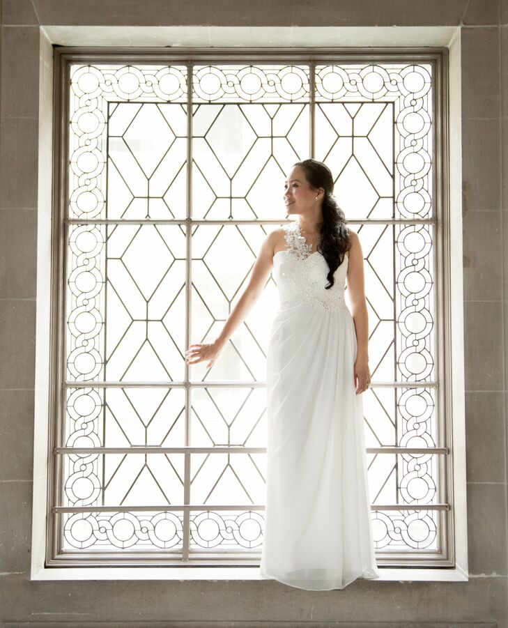 The bride wore a sheath gown with a sweetheart neckline, ruching at the waist and an intricate strap over one shoulder.
