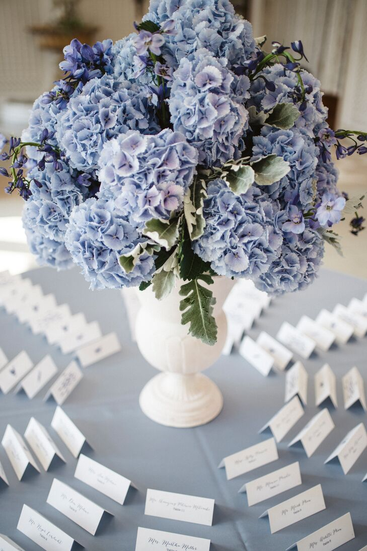 Guests found their seating arrangement in a pretty circular display around a floral centerpiece.