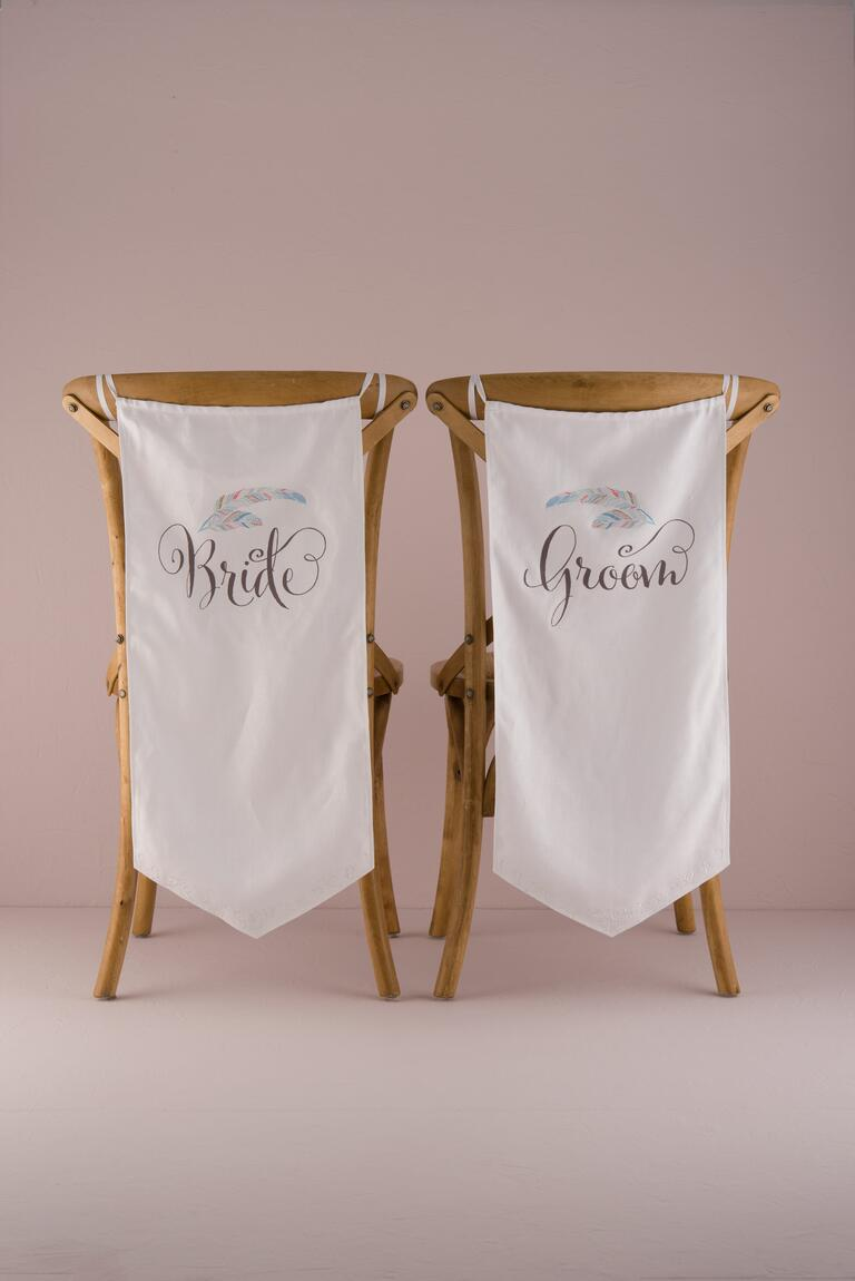 Bride and groom whimsical chair banners with feather decal
