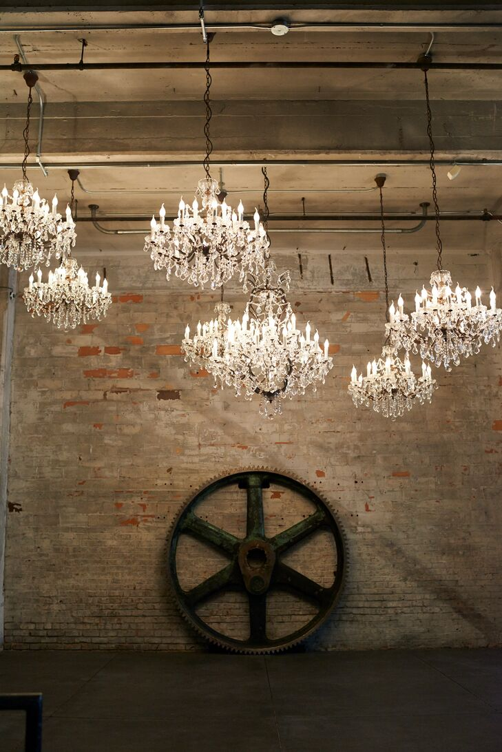 Elegant chandeliers popped against exposed brick at Aria -- an urban venue located in Minneapolis.