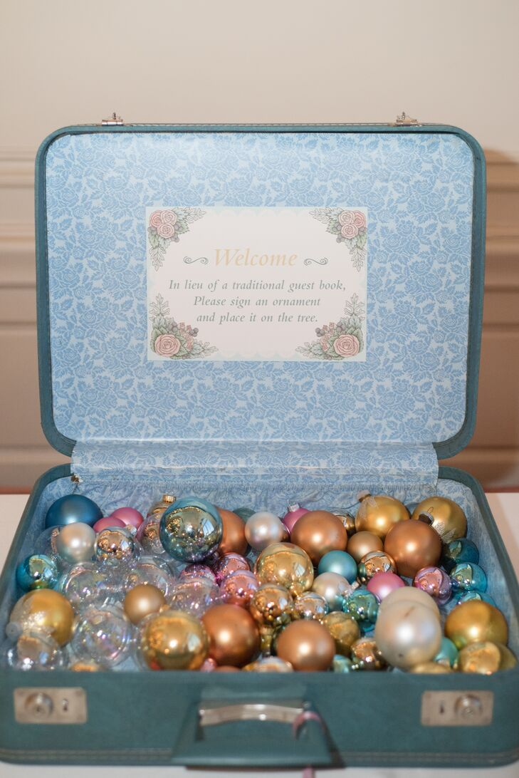 Guests wrote messages on vintage ornaments in lieu of a traditional sign-in book. The bride painted additional ornaments to be used as favors, and vintage decorations lined the aisles at the ceremony.