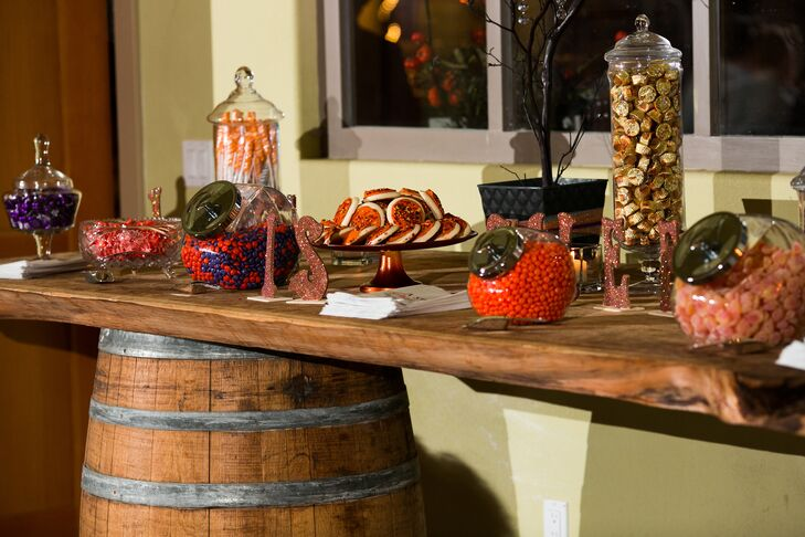 The dessert table had a wide assortment of candies and cookies for guests to eat or take home with them as wedding favors.
