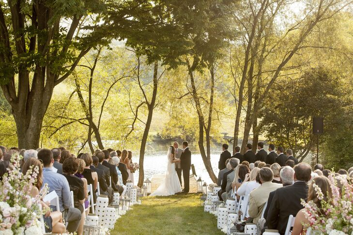 The ceremony took place pondside. Paige and Josh stood on the edge of a dock, framed by willow trees.