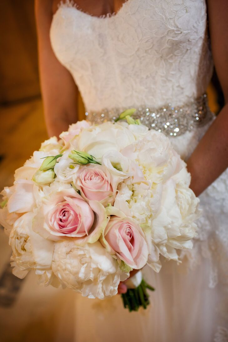 Lu carried a traditional bridal bouquet of white peonies, lisianthus and light pink roses.