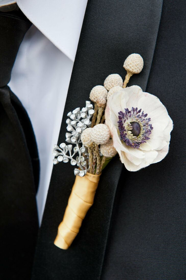 The groom's anemone boutonniere was wrapped in a gold ribbon to tie the color palette into his wedding-day look.