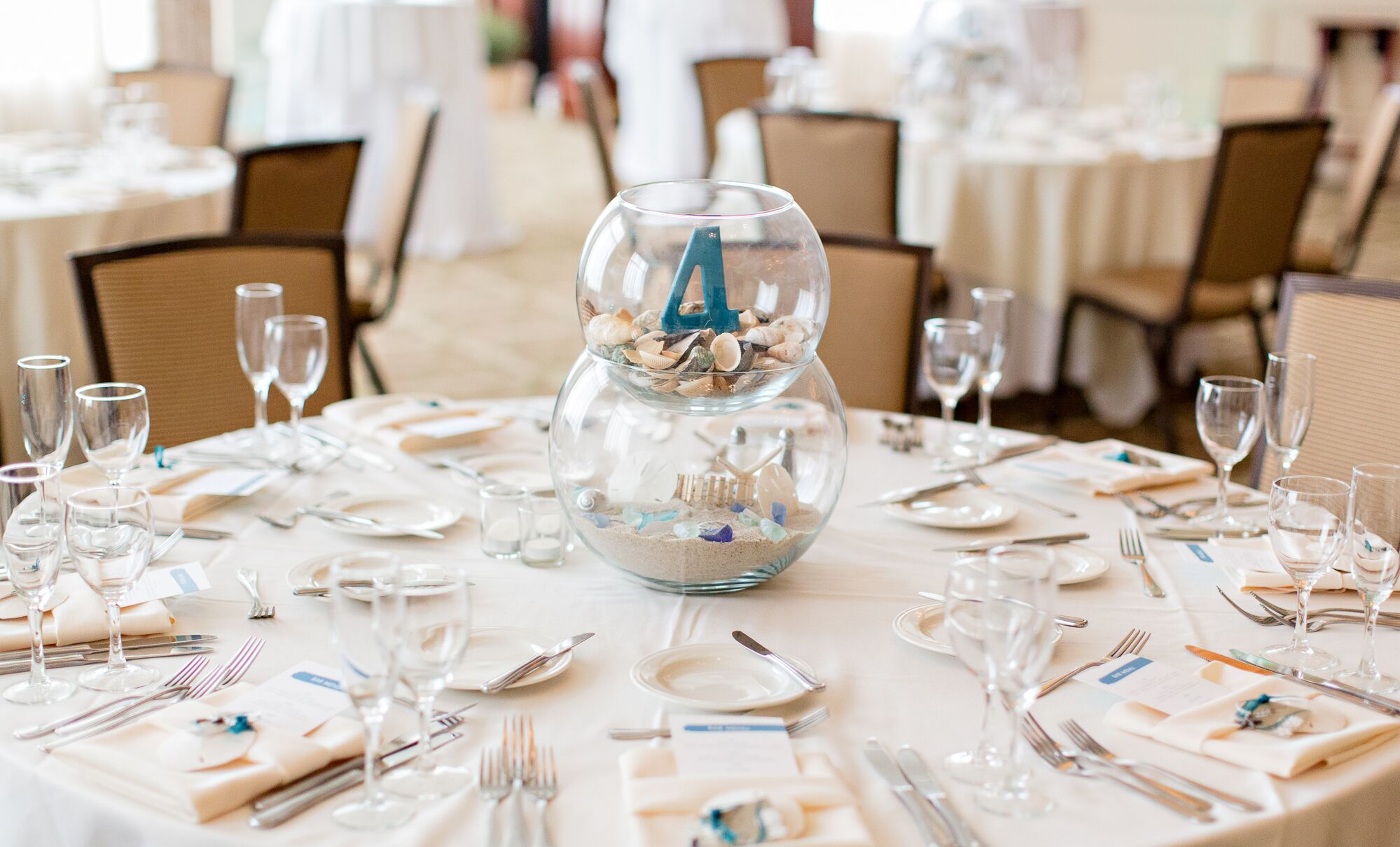 Beach Inspired Sand And Seashell Centerpieces