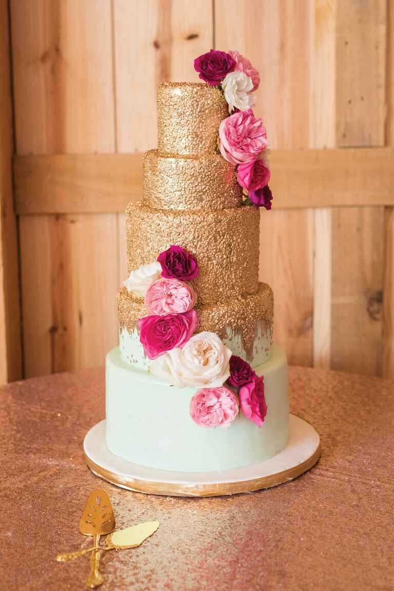 Glitzy wedding cake with hot pink blooms