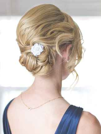 Classic updo hairstyle idea for brides or bridesmaids with a flower pin