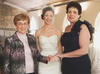 Grandmother, mother and bride portrait on wedding day