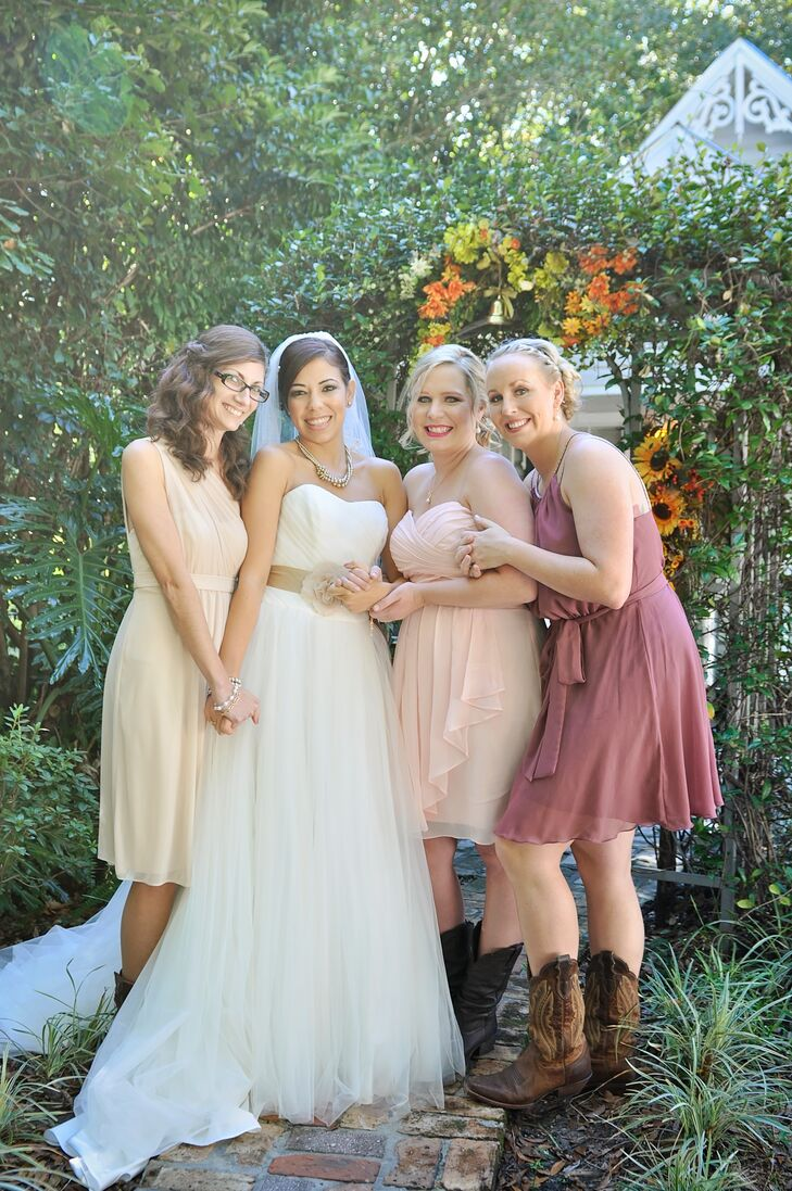 "Rather than just picking one look for the bridesmaids, they went with three. Each woman chose her knee-length chiffon dress in a dusty rose, ivory or blush hue. While their makeup, hairstyles and dress styles differed, the looks were tied together with these dark cowboy boots. ""I wanted them to feel comfortable,"" Heather says."